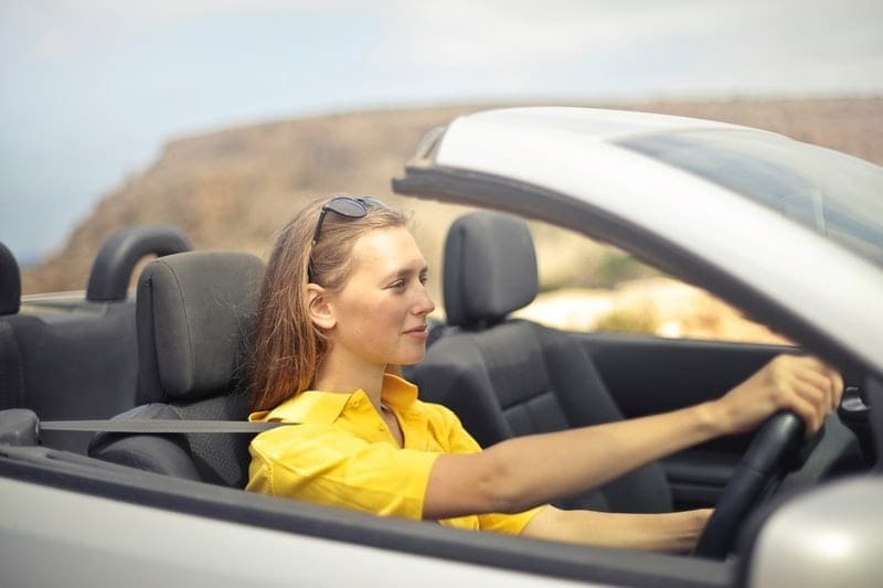 image of a girl driving car